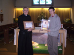 Revd. Owen Barraclough & Jeremy Hitchings with the Bliss Trophy and Certificate, April 2009